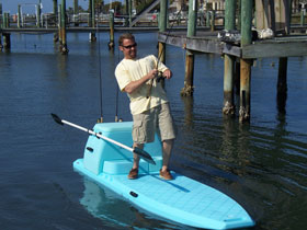 Photo of Man fishing off a Stand_up Paddle Board.